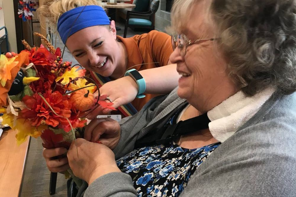 A caretaker and resident making a fall bouquet at The Springs of Mooresville in Mooresville, Indiana