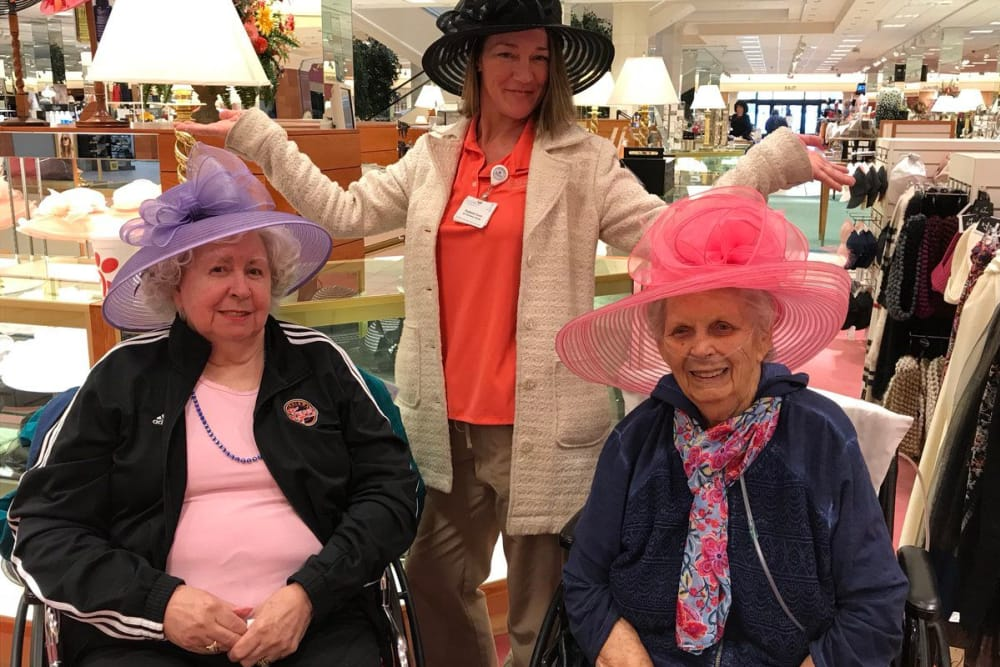 Residents and a caretaker from The Springs of Mooresville in Mooresville, Indiana in a shopping center with matching hats