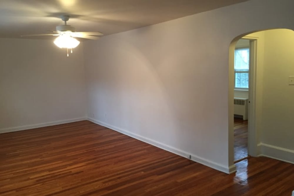 Open living area with hardwood floors at Oakmont Park Apartments in Scranton, Pennsylvania