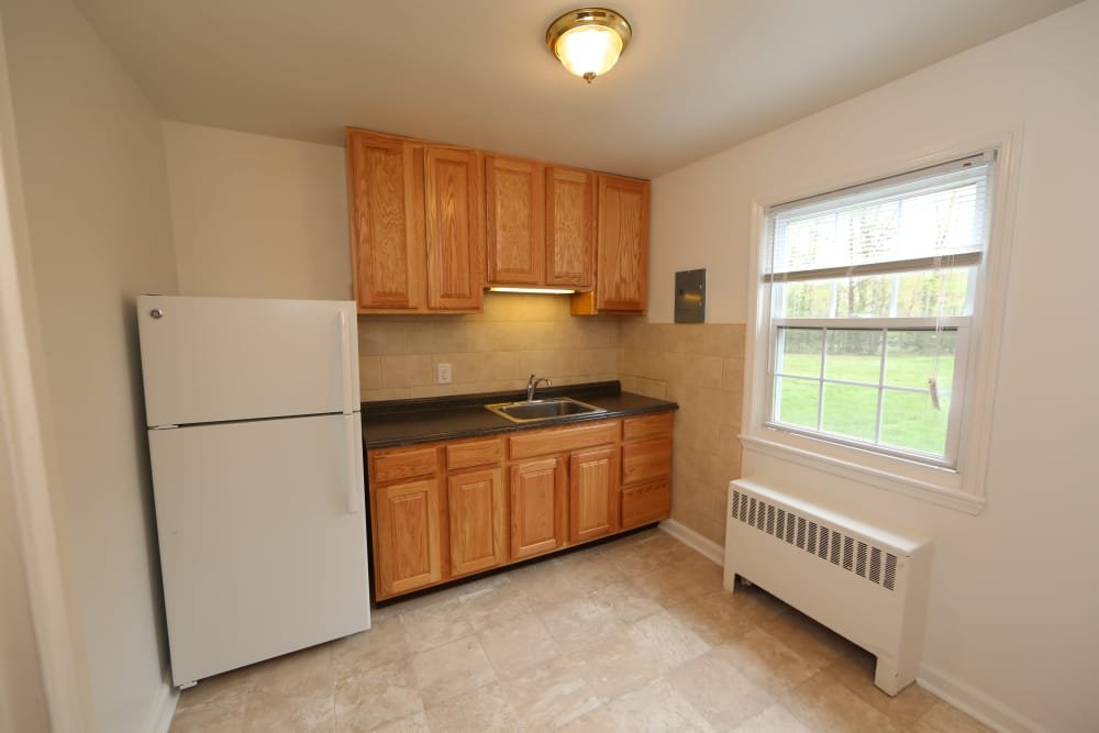 Naturally well-lit kitchen at Oakmont Park Apartments in Scranton, Pennsylvania