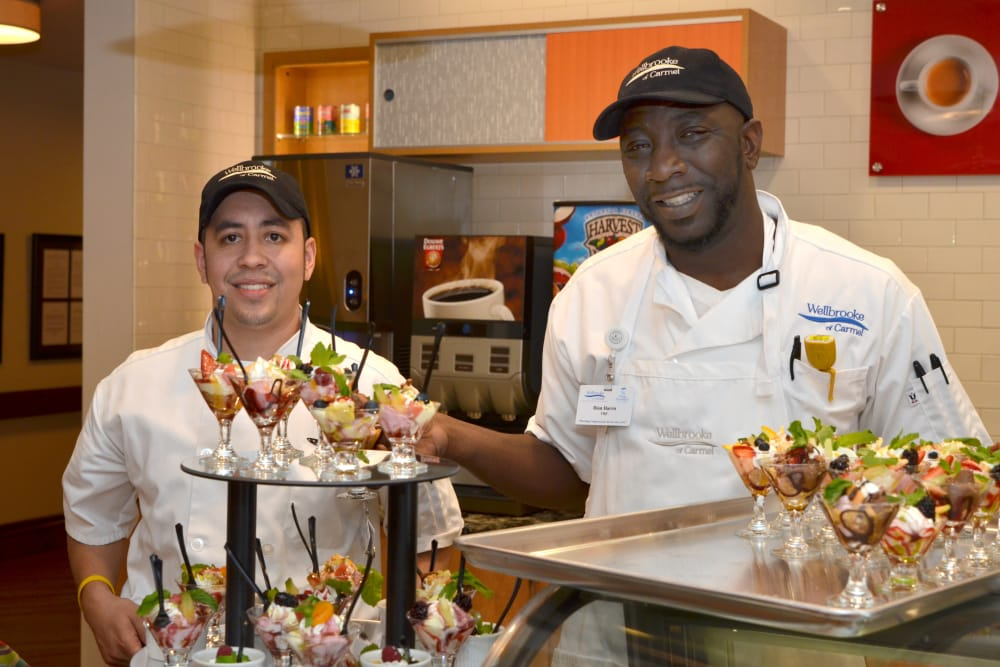 Two chefs with prepared desserts at Wellbrooke of Carmel in Carmel, Indiana