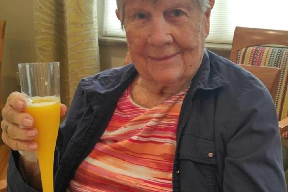 A resident holding a drink at Wellbrooke of Carmel in Carmel, Indiana