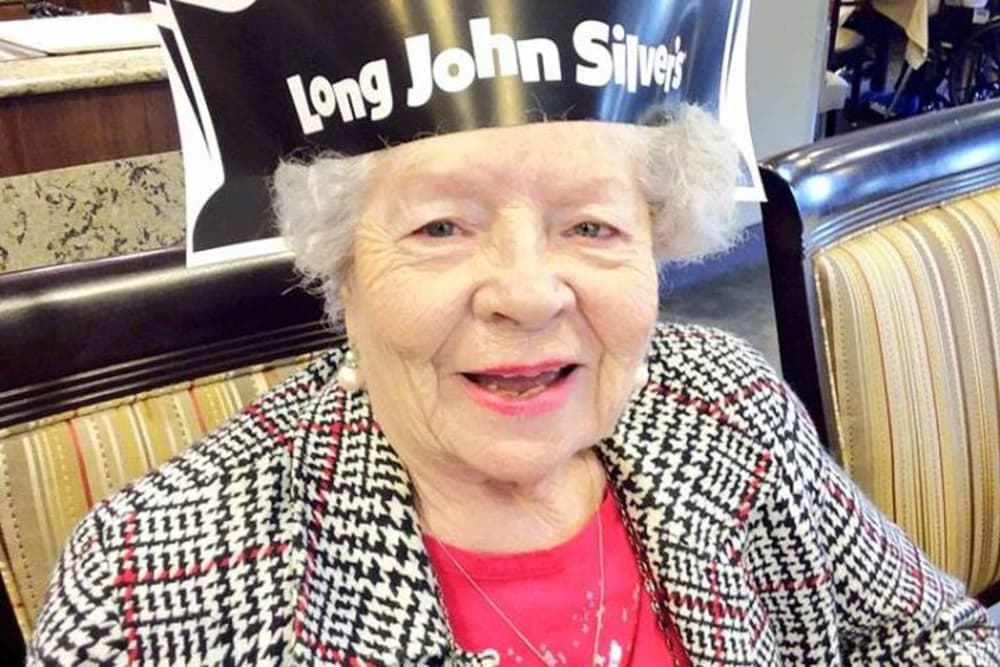 A happy resident from Wellbrooke of Crawfordsville in Crawfordsville, Indiana in a Long John Silver's hat