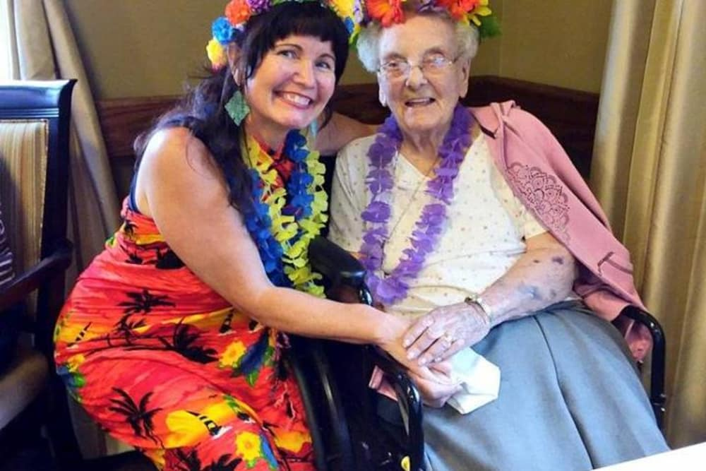 Residents dressed for a tropical party at Wellbrooke of Crawfordsville in Crawfordsville, Indiana