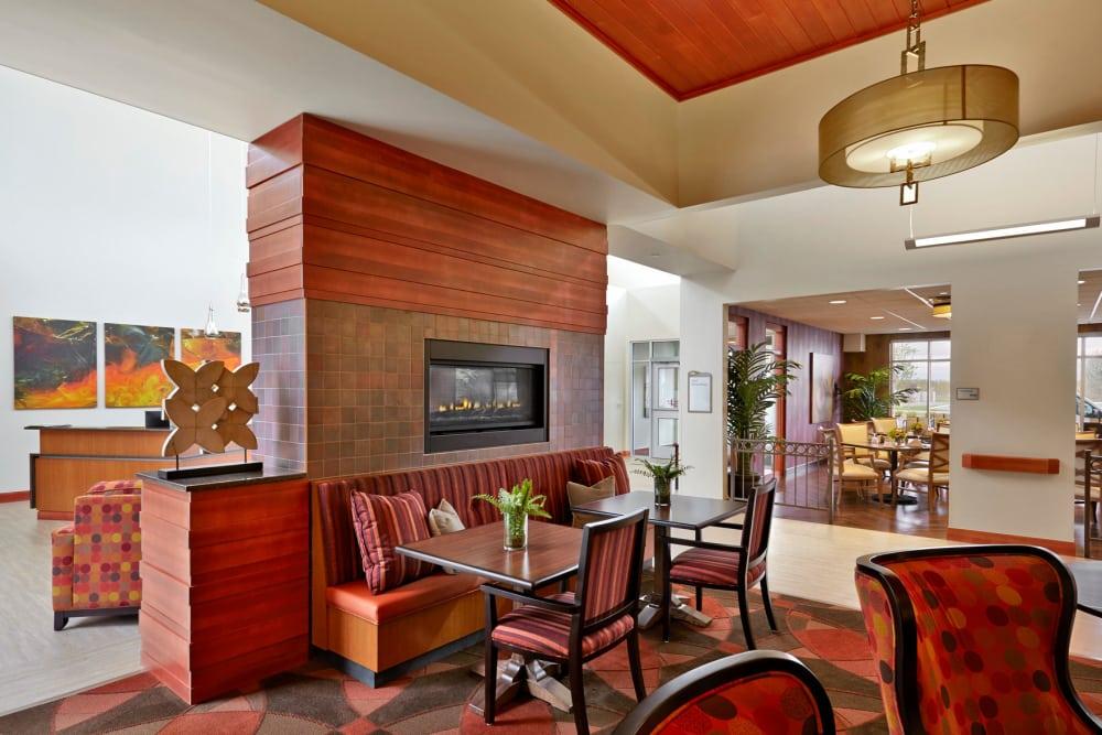 Fireside seating in the lounge at Wellbrooke of Kokomo in Kokomo, Indiana