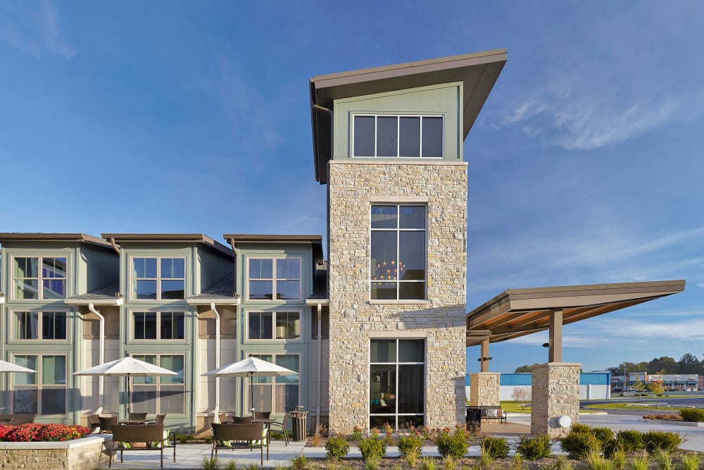 Building exterior with outdoor seating at Wellbrooke of South Bend in South Bend, Indiana