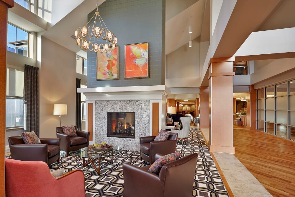 Cozy fireside seating at Wellbrooke of South Bend in South Bend, Indiana
