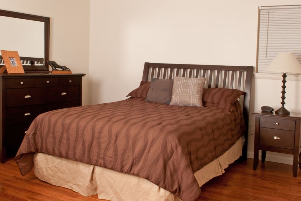 Beautiful bedroom with a comfy bed at Jamestown Square Apartments in Blackwood, New Jersey