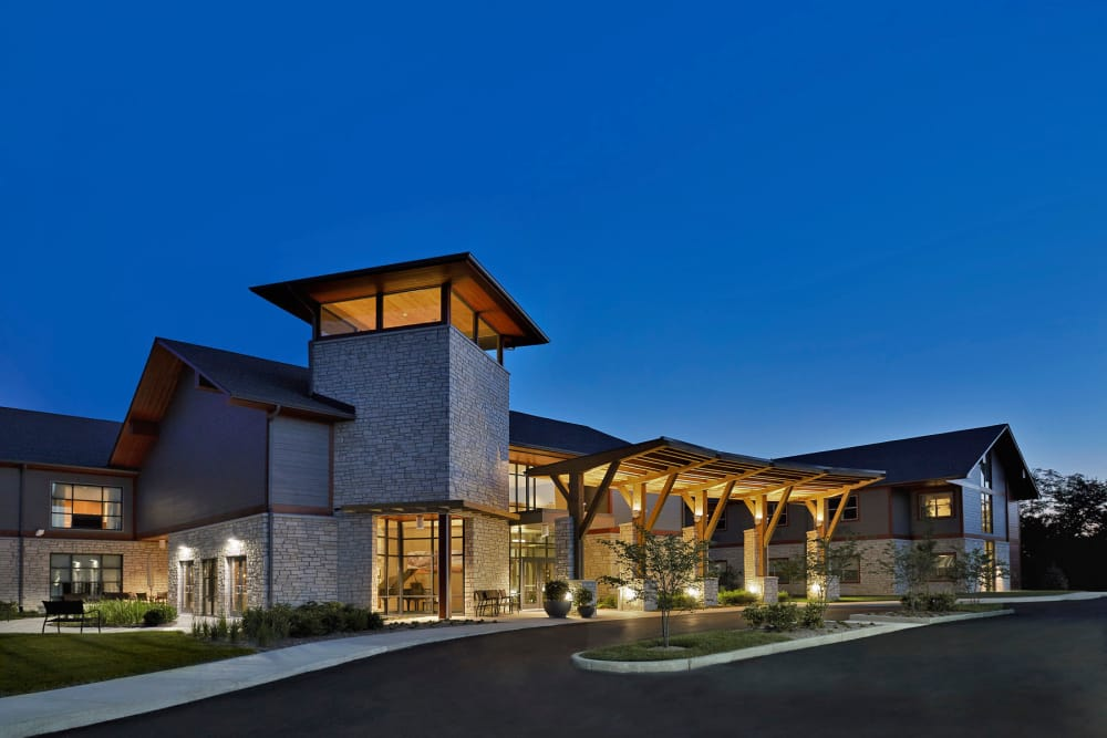 Building exterior at dusk at Wellbrooke of Westfield in Westfield, Indiana