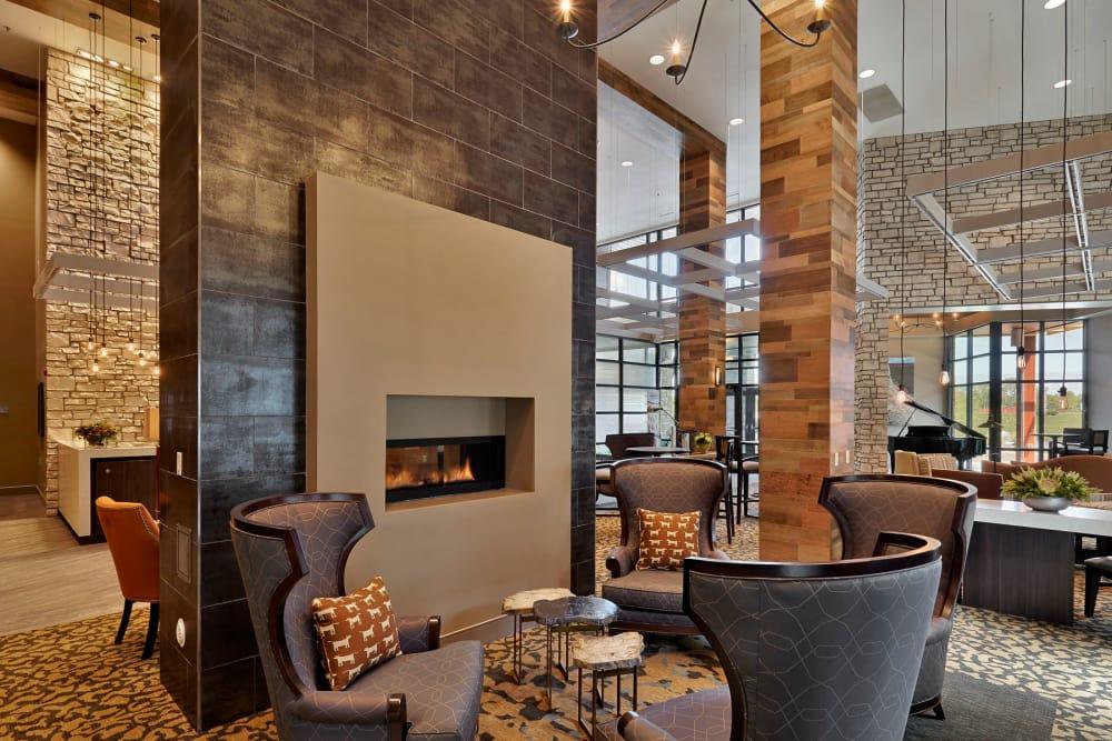 Cozy fireside seating at Wellbrooke of Westfield in Westfield, Indiana