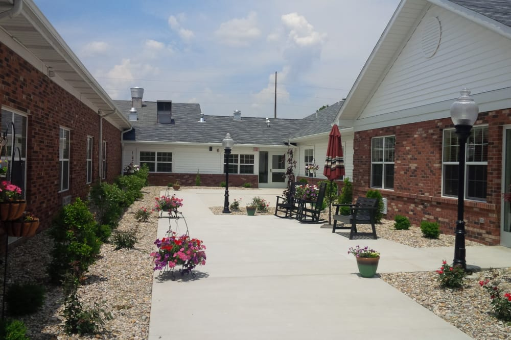 Outdoor seating and walkway at Amber Manor Care Center in Petersburg, Indiana