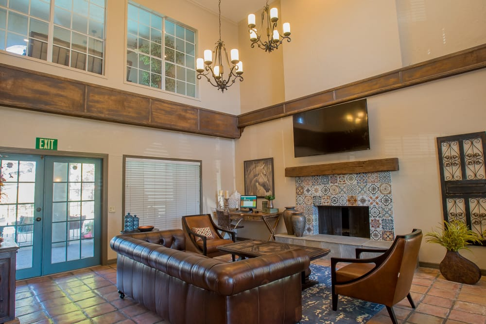Clubhouse with a fireplace at Barcelona Apartments in Tulsa, Oklahoma