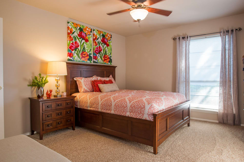 Bedroom with a ceiling fan at Barcelona Apartments in Tulsa, Oklahoma