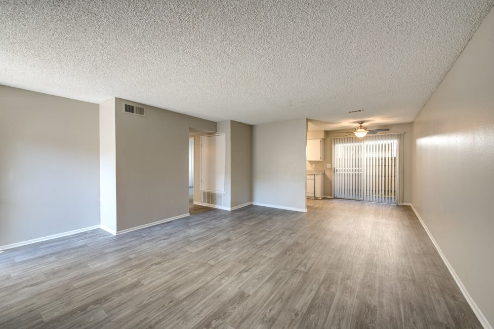 Open-concept floor plan with hardwood floors in apartment home at Sienna Heights Apartment Homes in Lancaster, California