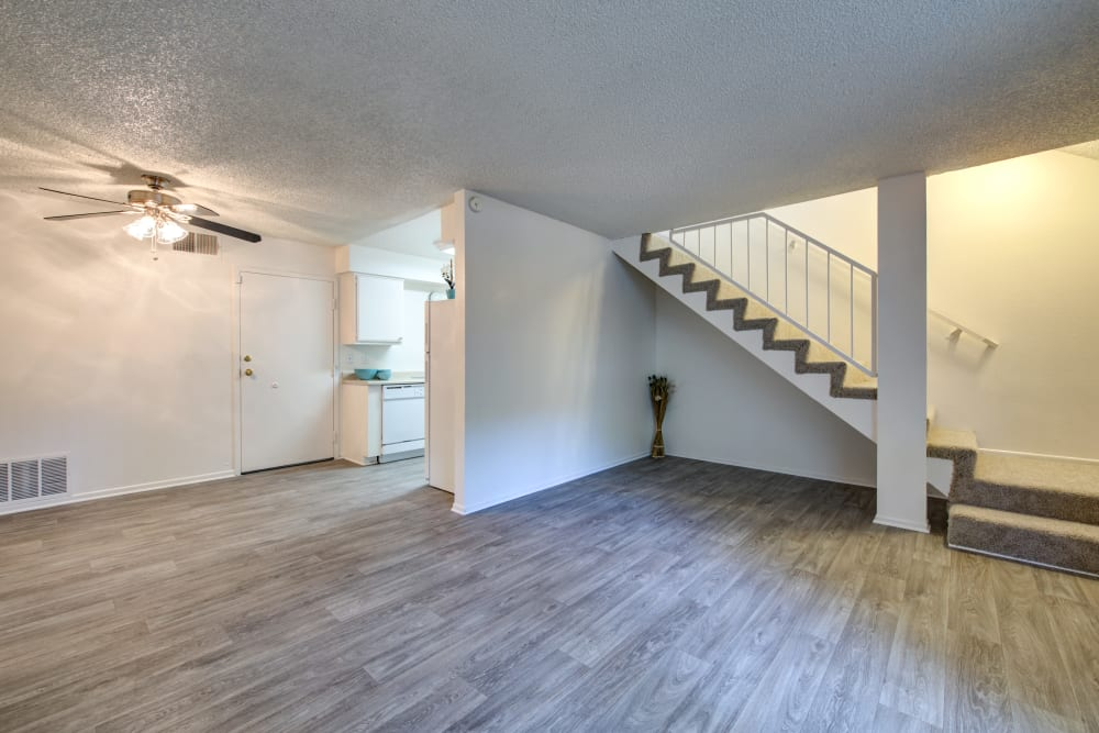 Multi-level home with hardwood floors and carpeted stairway at Sienna Heights Apartment Homes in Lancaster, California