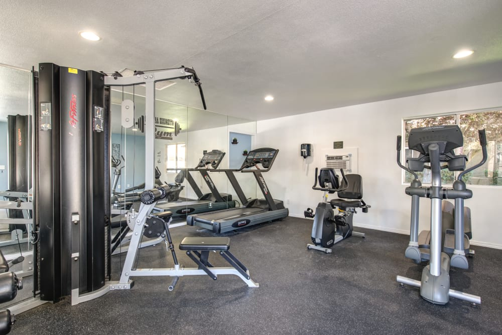 Well-equipped fitness center at Sienna Heights Apartment Homes in Lancaster, California