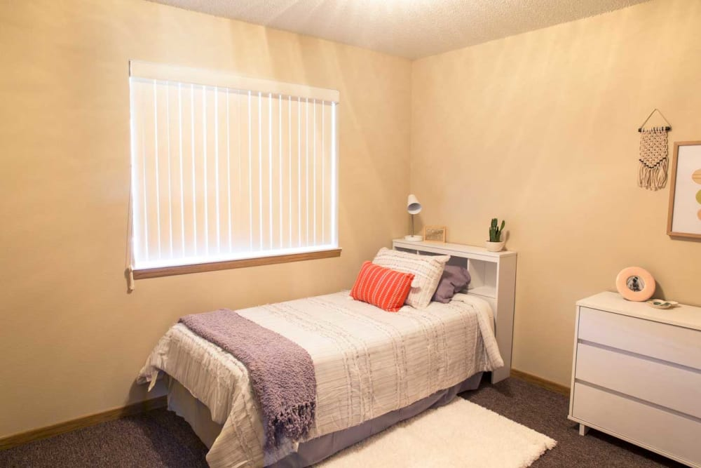 Well-lit bedroom at Kirkwood Village West in Cedar Rapids, Iowa
