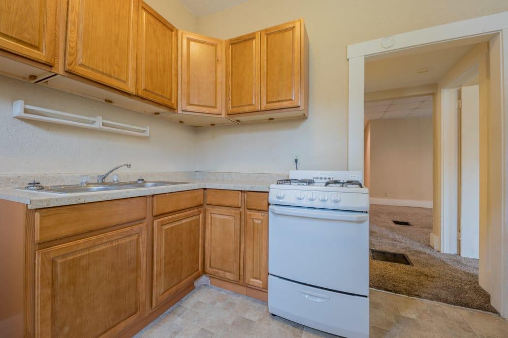 Kitchen with white appliances at Pleasant Street Apartments in Des Moines, Iowa