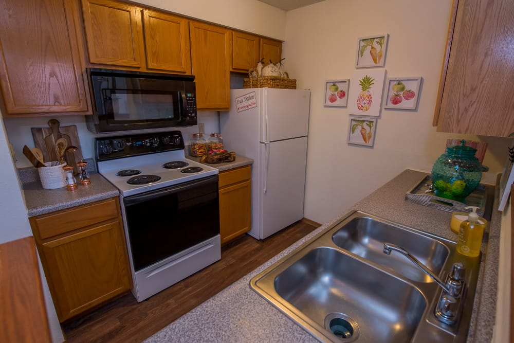 Spacious kitchen at Huntington Park Apartments in Wichita, Kansas