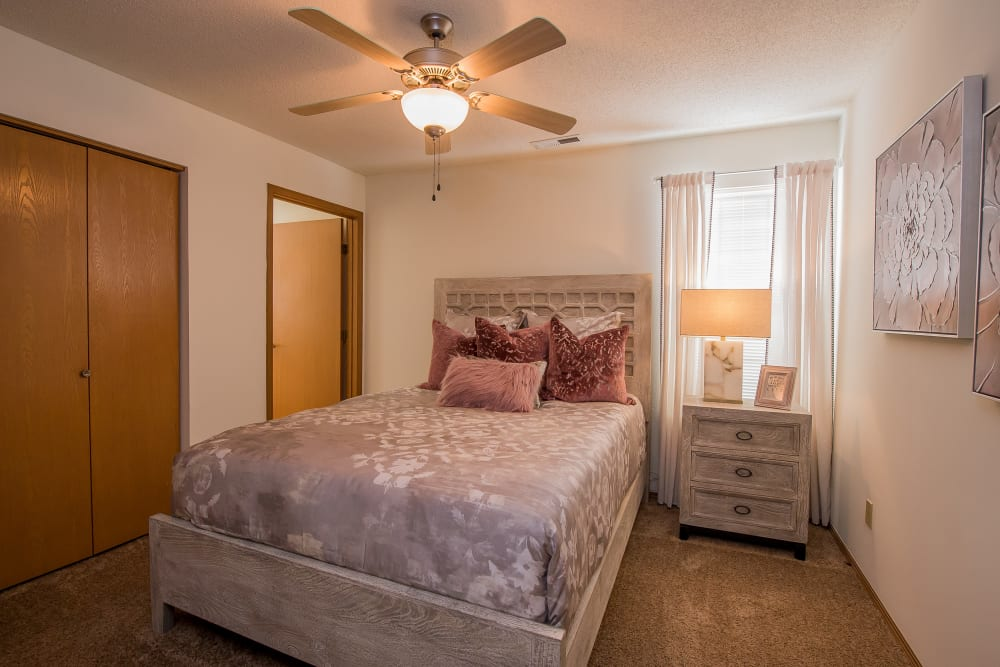 Bright bedroom at Huntington Park Apartments in Wichita, Kansas