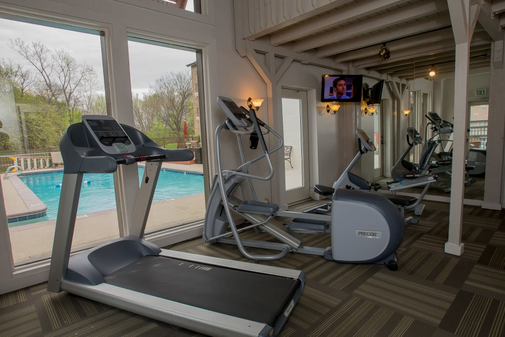 Fitness center with a view of the pool at Polo Run Apartments in Tulsa, Oklahoma