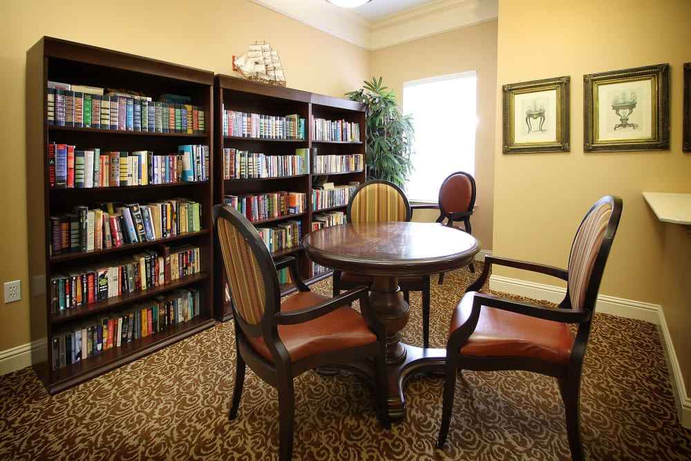 Library room with a table for reading at Reunion Court of The Woodlands in The Woodlands, Texas