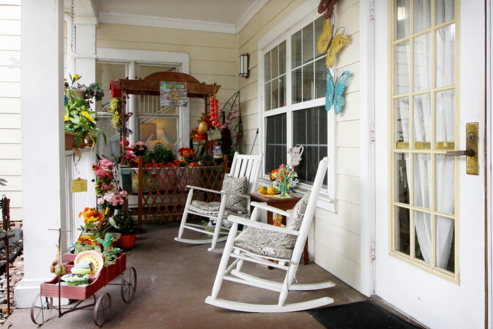 Porch with rocking chairs at Reunion Court of The Woodlands in The Woodlands, Texas