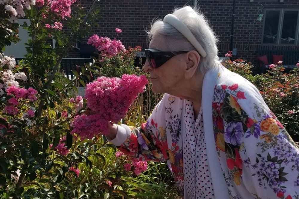 A resident smelling the flowers at Autumn Woods Health Campus in New Albany, Indiana