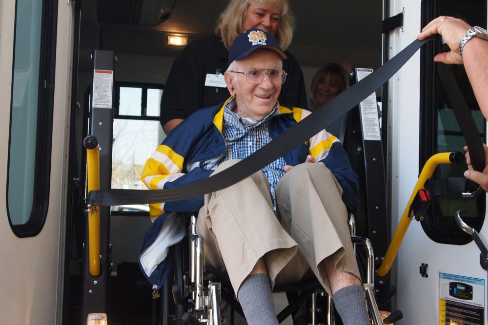 A resident in a wheelchair getting off the community bus at Avalon Springs Health Campus in Valparaiso, Indiana