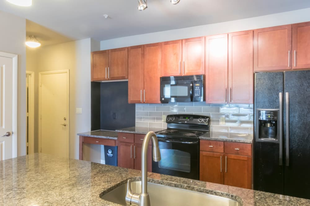 Model kitchen inside apartment at McBee Station in Greenville, South Carolina
