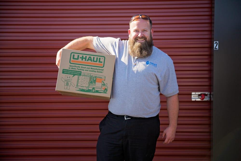 Employee holding uhaul box at Nest Self Storage in Salem, Oregon