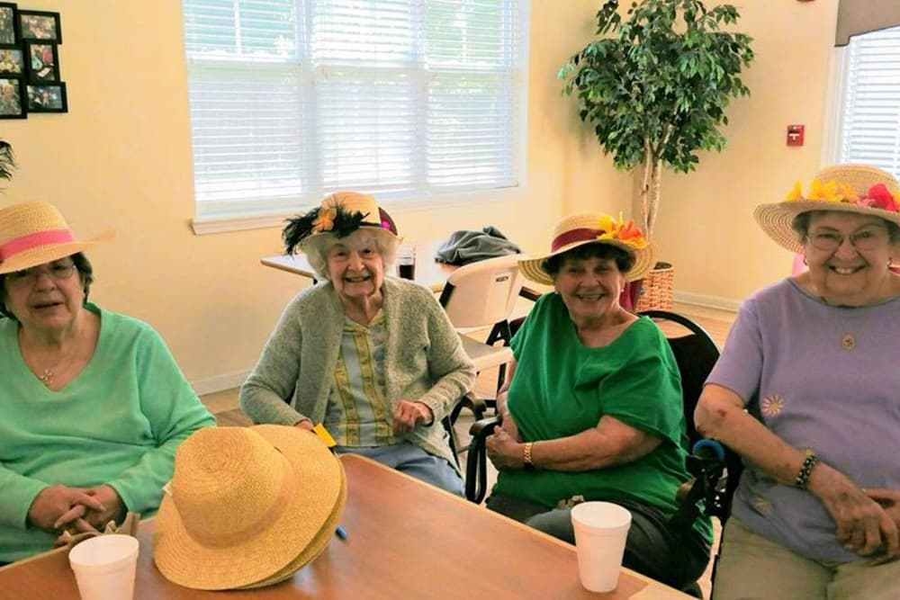 Ladies smiling and having drinks at Franciscan Health Care Center in Louisville, Kentucky