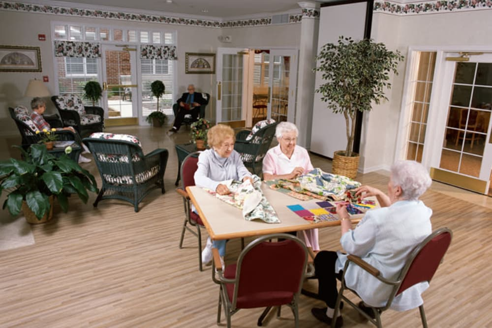 Senior residents playing cards at Franciscan Health Care Center in Louisville, Kentucky