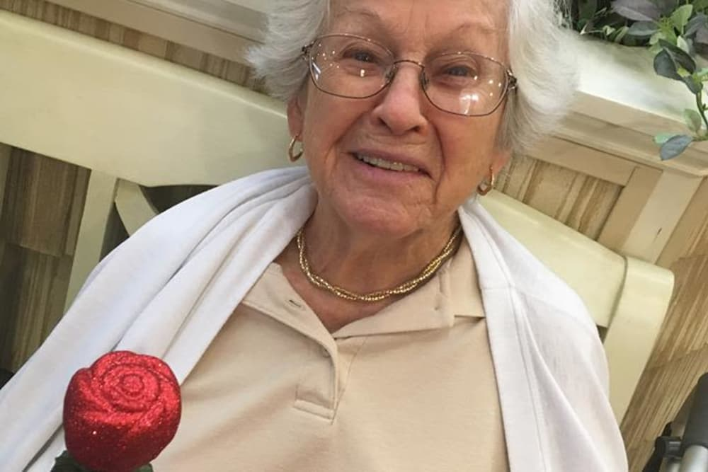 A resident holding a sparkly rose at Cypress Pointe Health Campus in Englewood, Ohio