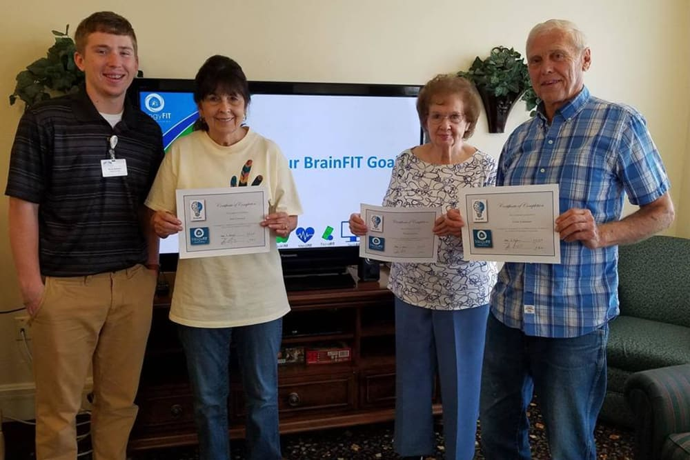 Residents holding their Brain Fit certificates at River Pointe Health Campus in Evansville, Indiana