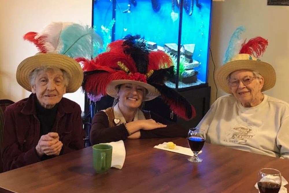 Group of smiling ladies with hats at Glen Oaks Health Campus in New Castle, Indiana