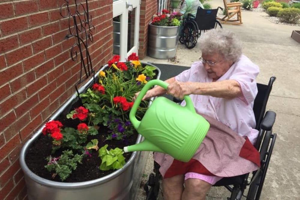 Lady taking care of the garden at Glen Ridge Health Campus in Louisville, Kentucky