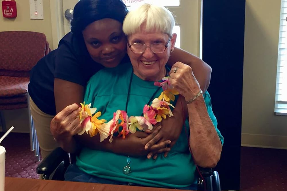 Resident senior and nurse hugging at Glen Ridge Health Campus in Louisville, Kentucky