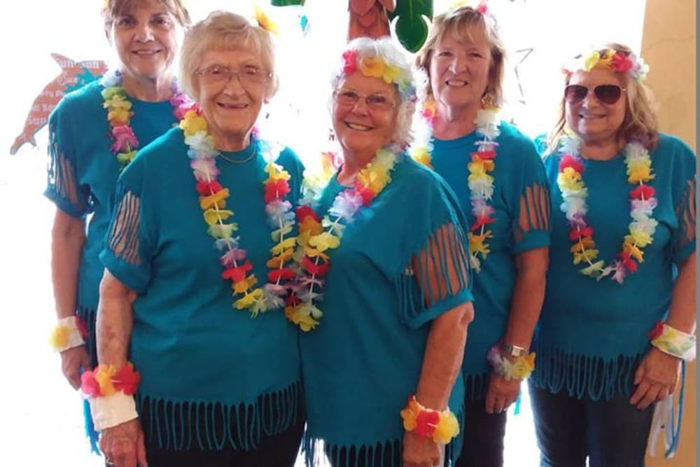 A group of residents dressed in tropical clothing at Forest Park Health Campus in Richmond, Indiana