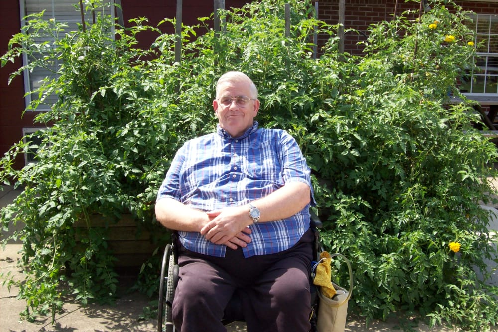 Resident relaxing on a sunny day outdoors at Highland Oaks Health Center in McConnelsville, Ohio