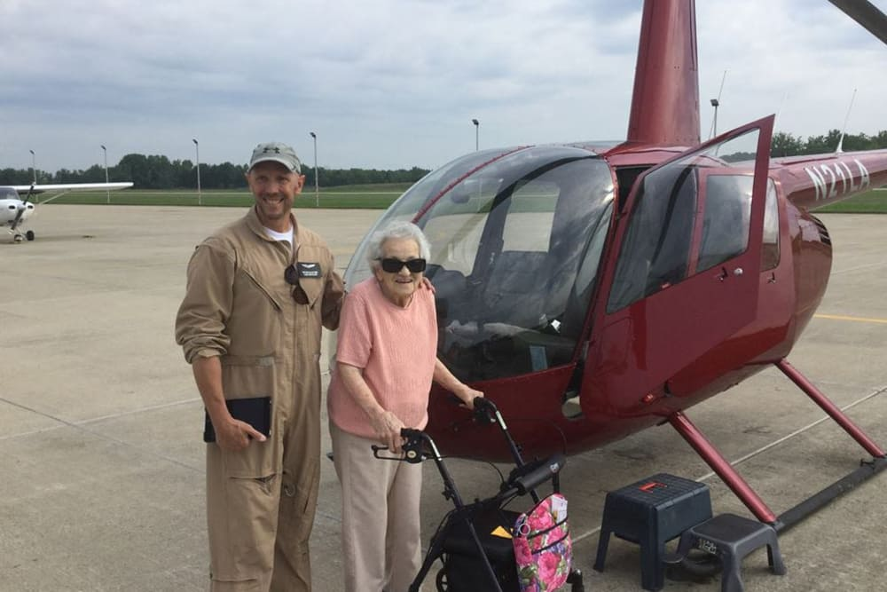 Pilot and resident posing next to helicopter in Lebanon, Indiana near Homewood Health Campus