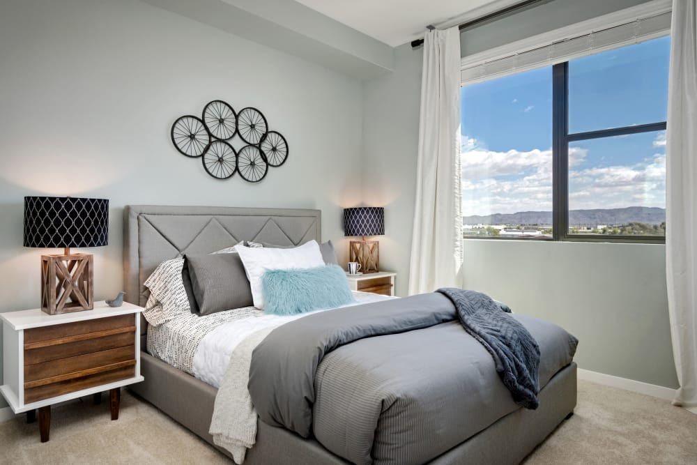 Large master bedroom with beautiful furnishings in model home at Capital Place in Phoenix, Arizona