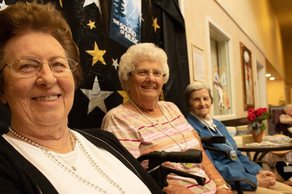 Three female residents smiling for a photo at Springview Manor in Lima, Ohio