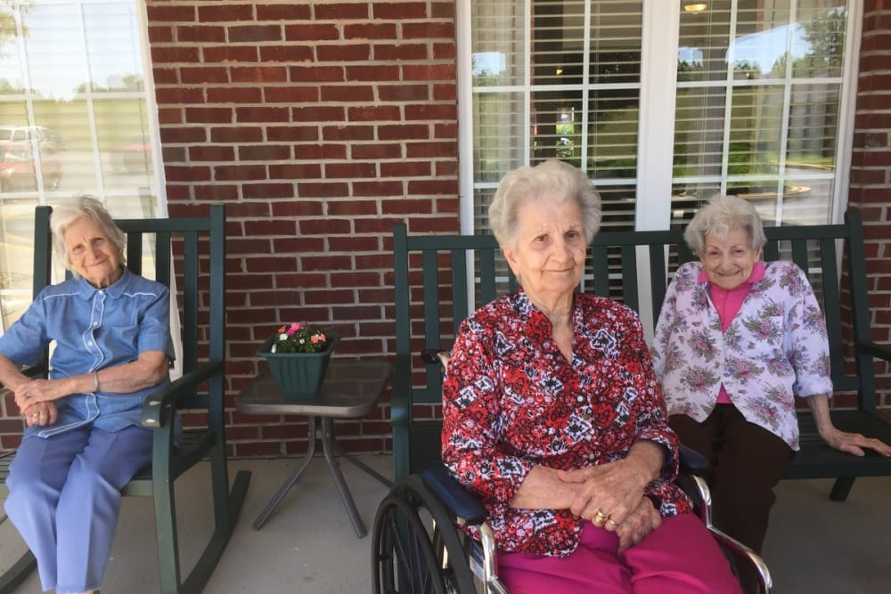 Female residents lounging outside in the courtyard at StoneBridge Health Campus in Bedford, Indiana