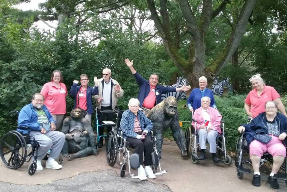 Residents and staff go on a trip to the Zoo and take a photo near the gorilla statues at The Lakes of Monclova in Maumee, Ohio