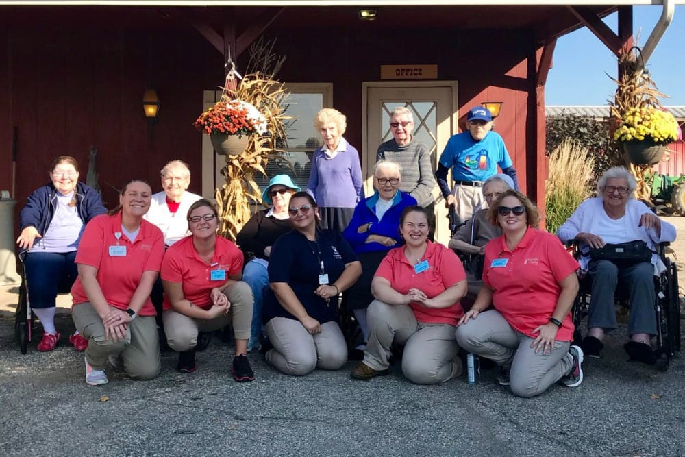 Residents and staff outdoors enjoying the fall colors at Waterford Crossing in Goshen, Indiana