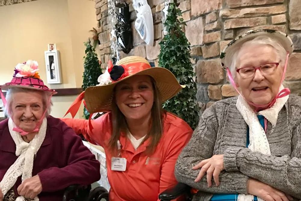 Residents and staff dress in hats for My Fair Lady theme day at Waterford Crossing in Goshen, Indiana