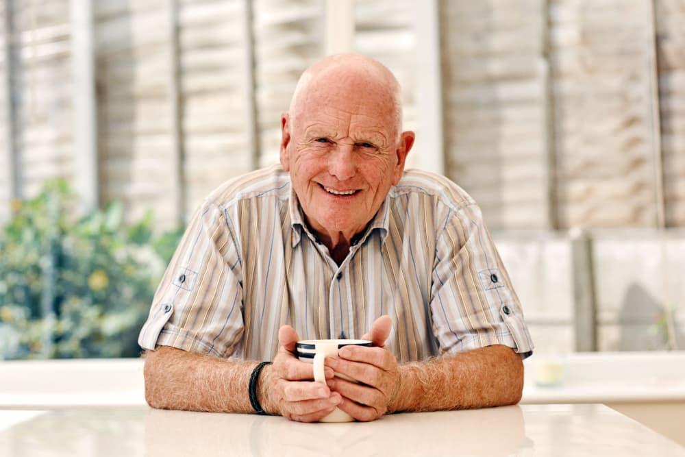 Senior resident having a laugh outside Vista Village Senior Living in Vista, California
