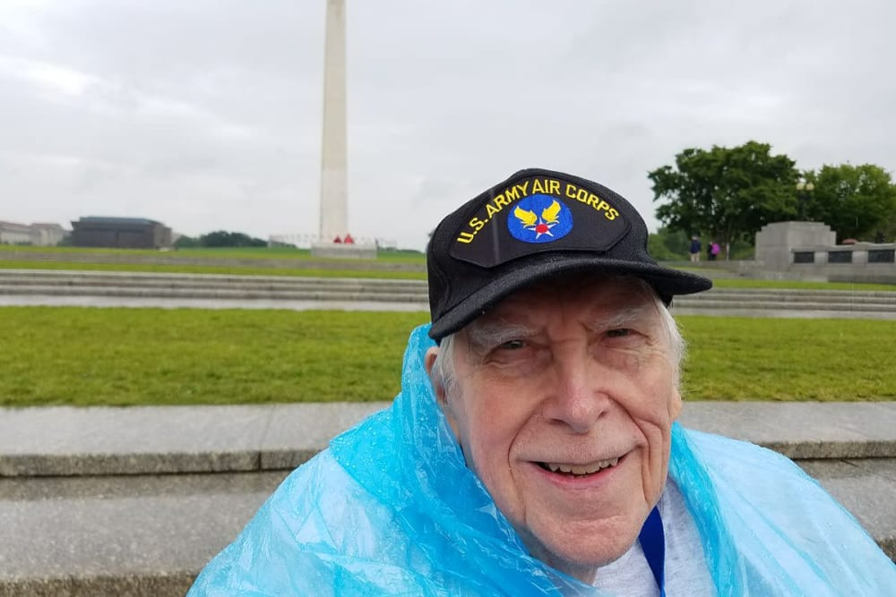 A veteran from Ridgewood Health Campus in Lawrenceburg, Indiana in front of a monument