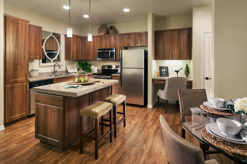 Open-concept floor plan with hardwood floors in model home at San Paseo in Phoenix, Arizona